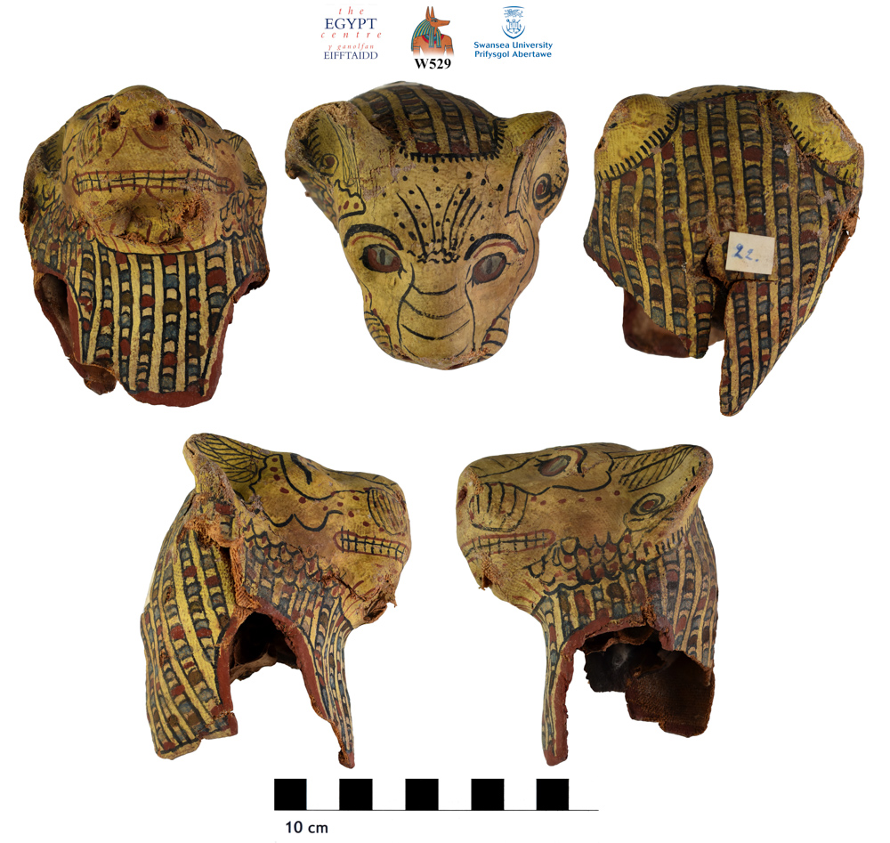 Image for: Cartonnage mask of a cat with remains of skull inside